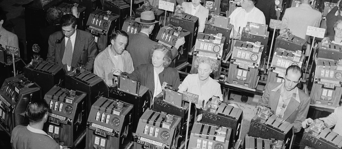20th December 1950:  Row upon row of slot machines at Harold's Club, the largest gambling house in Reno, Nevada.  (Photo by Doreen Spooner/Keystone Features/Getty Images)