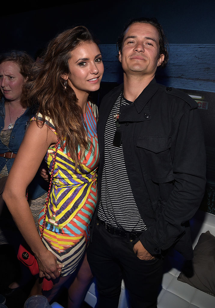 "SAN DIEGO, CA - JULY 25: Actors Nina Dobrev and Orlando Bloom attend the Playboy and A&E ""Bates Motel"" Event During Comic-Con Weekend, on July 25, 2014 in San Diego, California. (Photo by Jason Kempin/Getty Images for Playboy)"