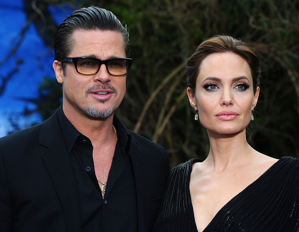"LONDON, ENGLAND - MAY 08:  Brad Pitt and Angelina Jolie attend a private reception as costumes and props from Disney's ""Maleficent"" are exhibited in support of Great Ormond Street Hospital at Kensington Palace on May 8, 2014 in London, England.  (Photo by Anthony Harvey/Getty Images)"