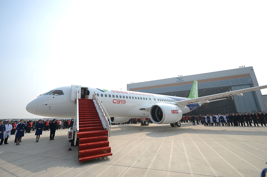 SHANGHAI, CHINA - NOVEMBER 02:  (CHINA OUT) China's first self-developed large passenger jetliner C919 is presented after it rolled off the production line at Shanghai Aircraft Manufacturing Co., Ltd on November 2, 2015 in Shanghai, China. The C919 jet developed by Commercial Aircraft Corporation of China, Ltd. (COMAC) is scheduled to make its maiden flight in 2016..  (Photo by VCG/VCG via Getty Images)