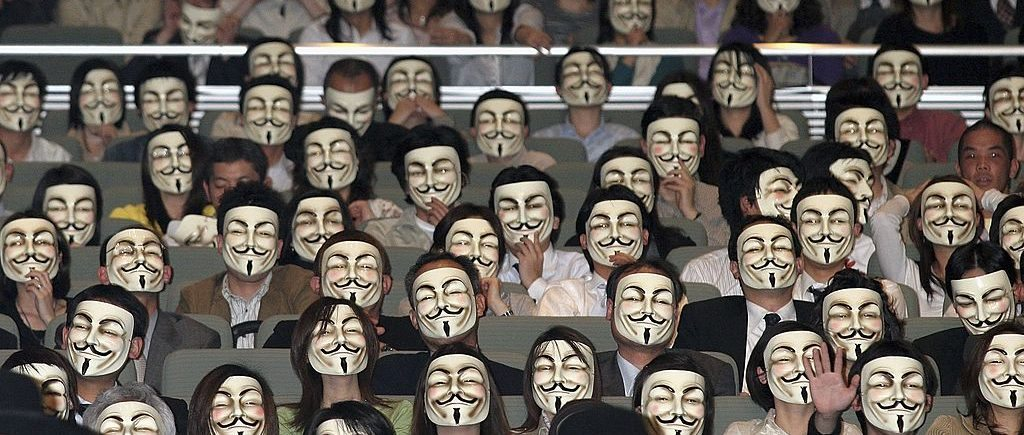 "TOKYO - APRIL 17:  General view of the audience wearing masks during the Japanese premiere of ""V for Vendetta"" at Kokusai Forum on April 17, 2006 in Tokyo, Japan. The film directed by James McTeigue will open on April 22nd in Japan. (Photo by Junko Kimura/Getty Images)"