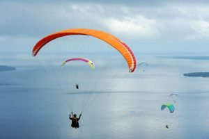 MANADO, INDONESIA - MARCH 17: Paragliders fly during the Paragliding Accuracy World Cup 1st Series 2017 at Mount Tumpa on March 17, 2017 in Manado, Indonesia. (Photo by Robertus Pudyanto/Getty Images)